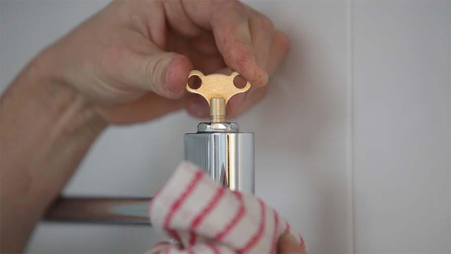 towel radiator key turning in the bleed nipple
