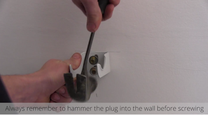 How to Install a Radiator_15_Hammer the Plug into the wall