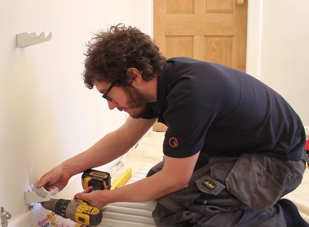 How to Install a Radiator_16_Drill Brackets to the wall