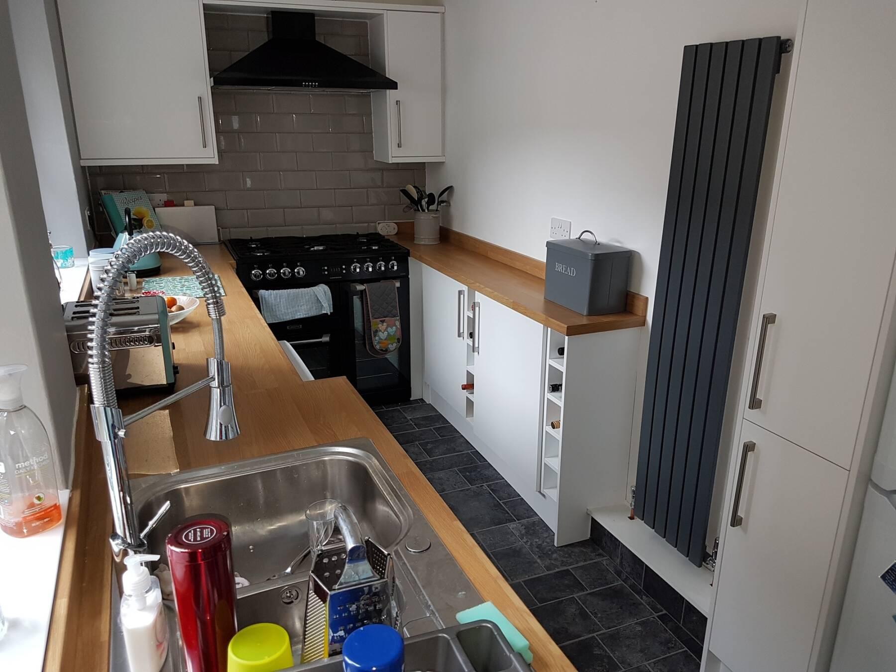 Milano Capri designer radiator in a galley kitchen in grey