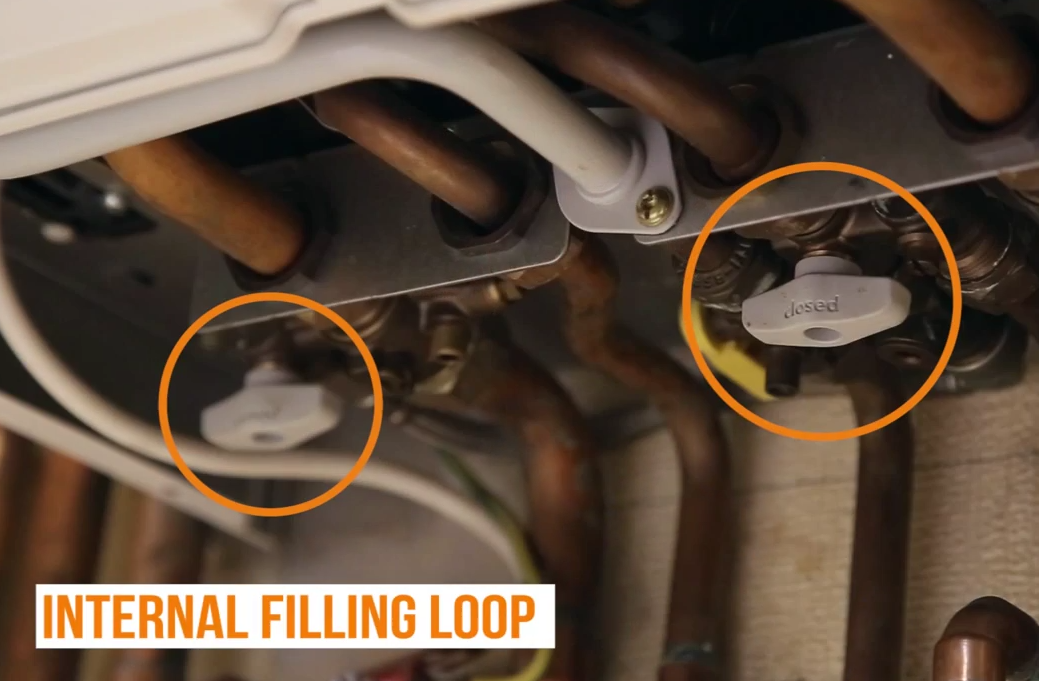 Internal filling loop taps for a central heating boiler