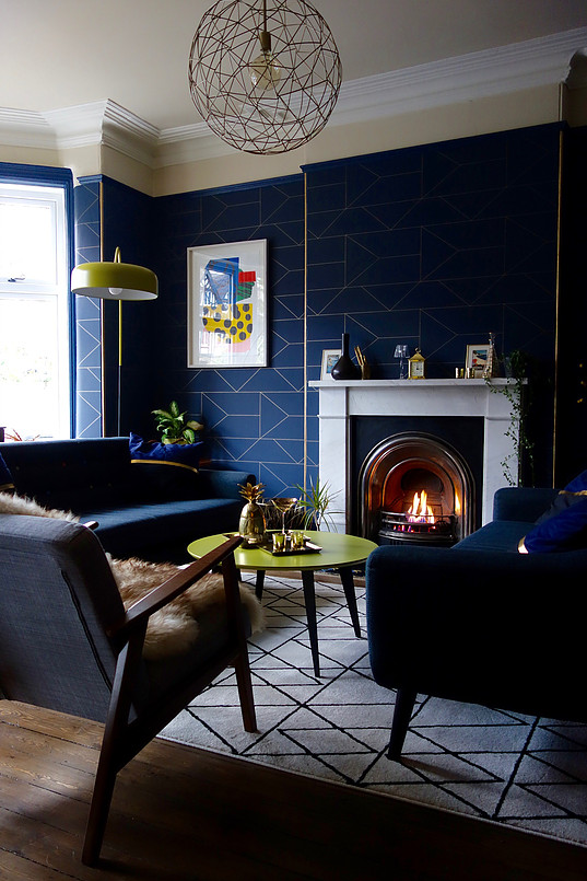 Blue sitting room with white fireplace and amazing design structure