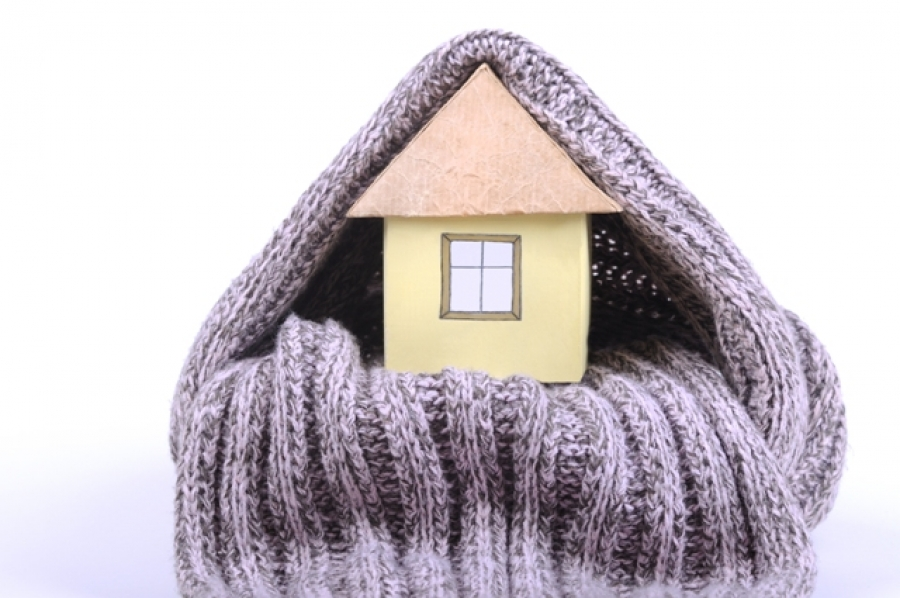 A house wrapped up in a scarf to keep it warm