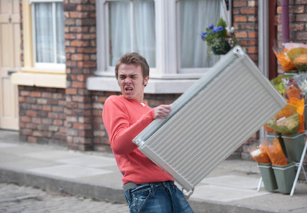 David platt carrying a radiator on coronation street