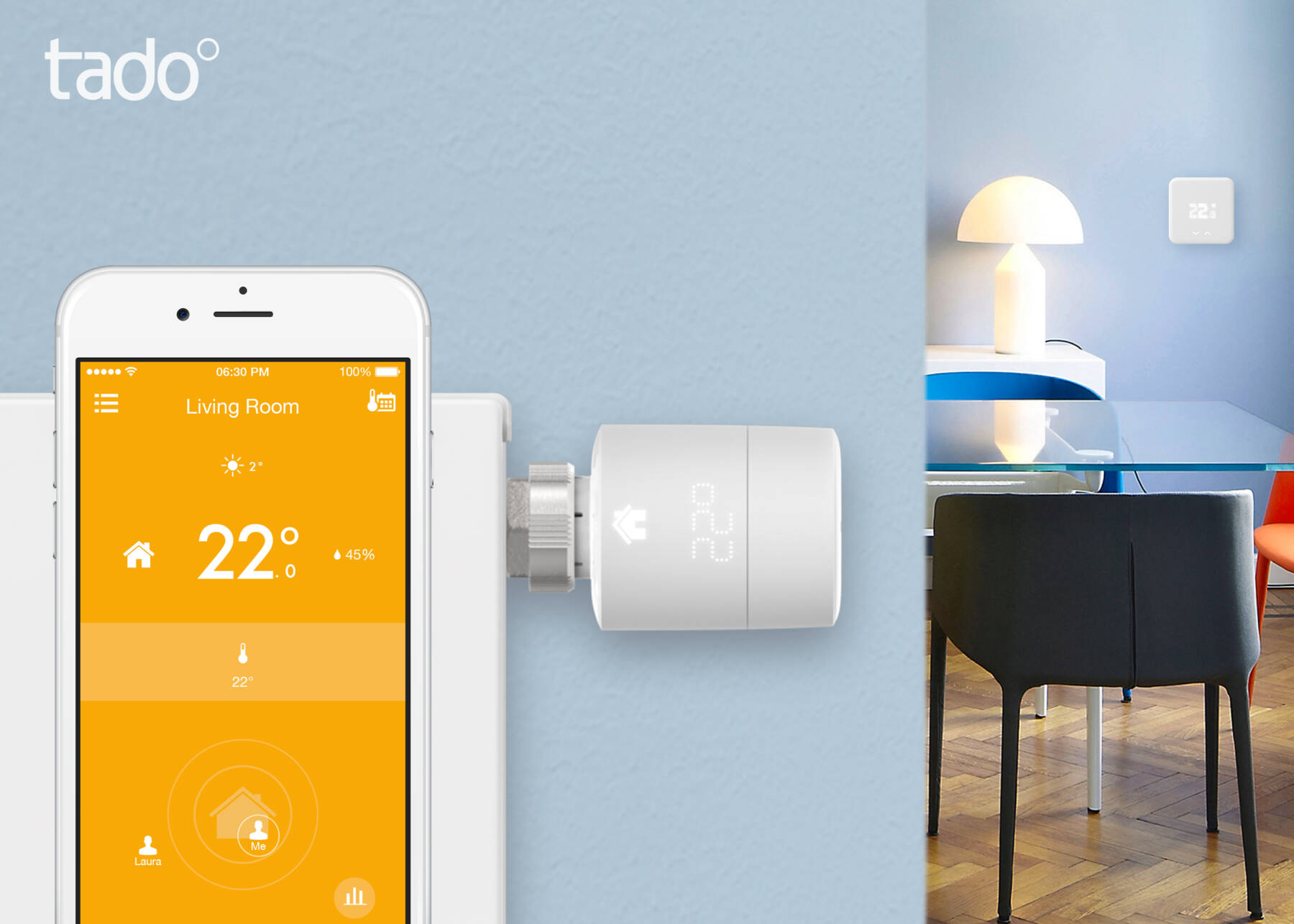 a mobile phone with the tado app open and the radiator thermostat in the background
