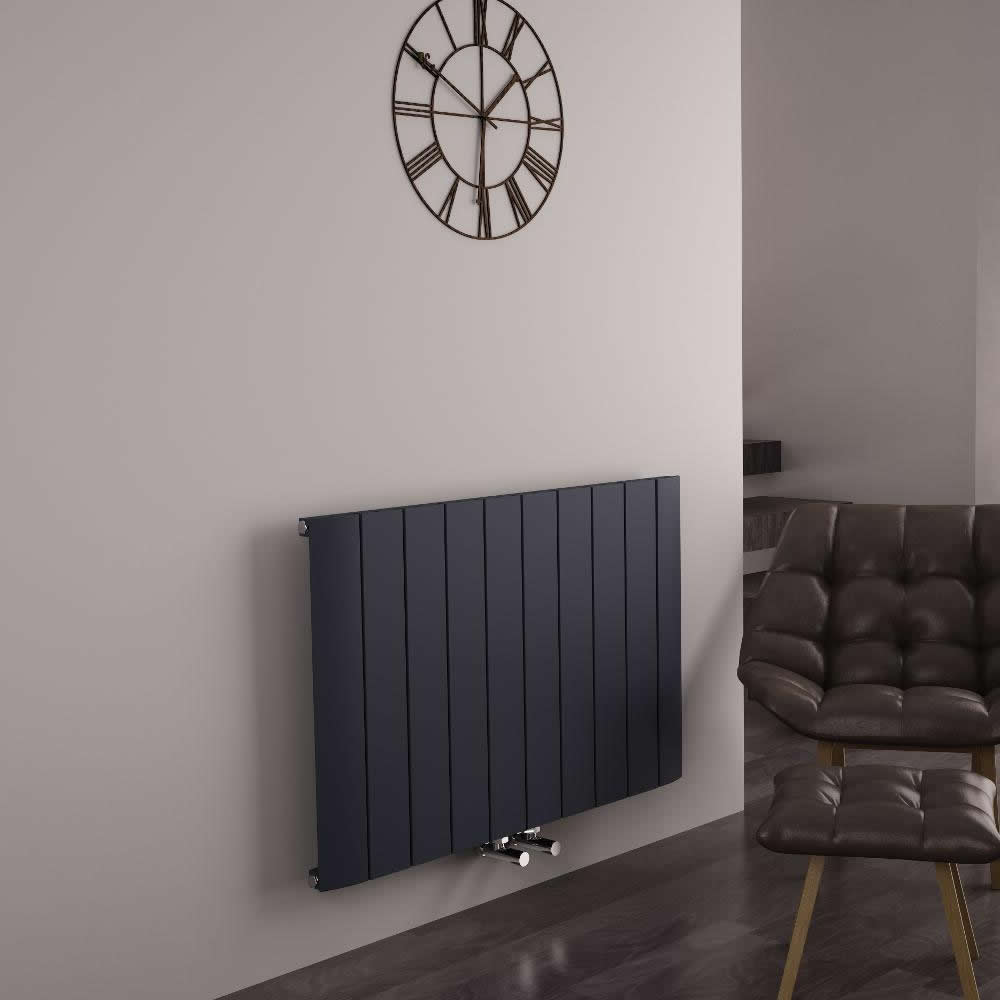 anthracite grey middle connection designer radiator on a coffee coloured wall in a sitting room
