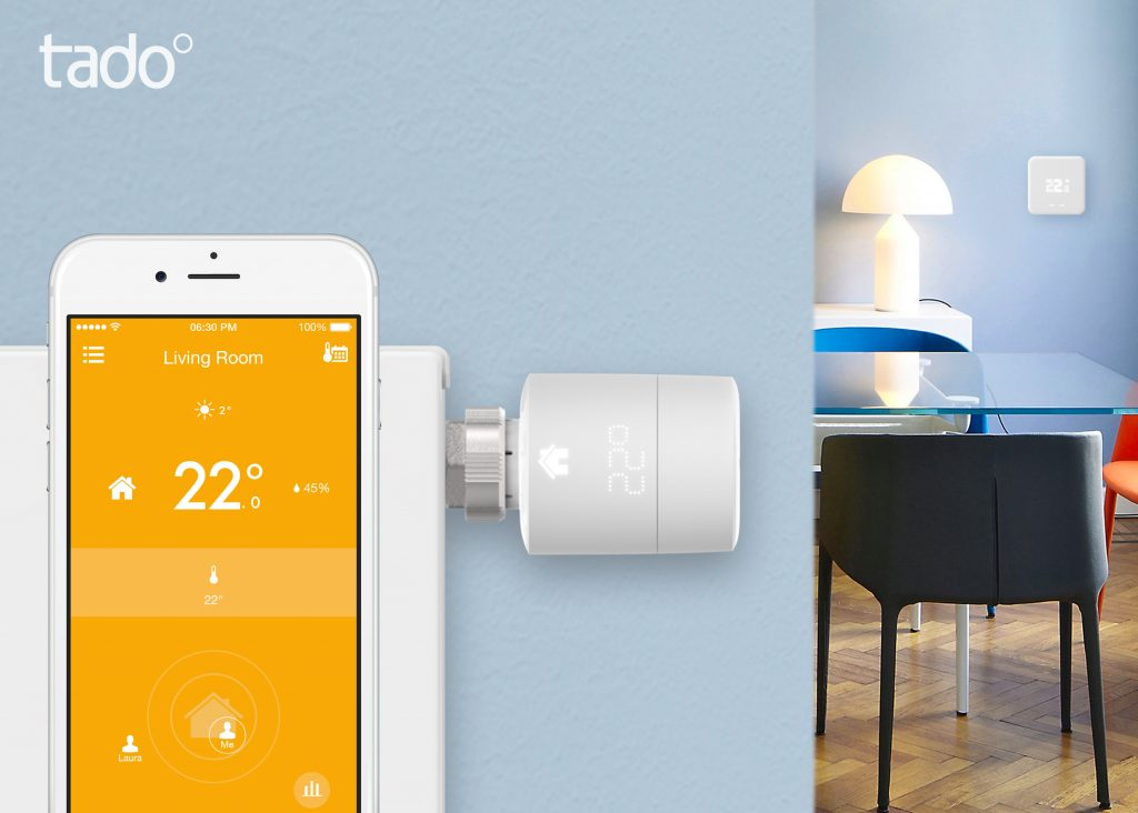 A visual representation of the tado smart app being used with a picture of the tado smart radiator thermostat in the background