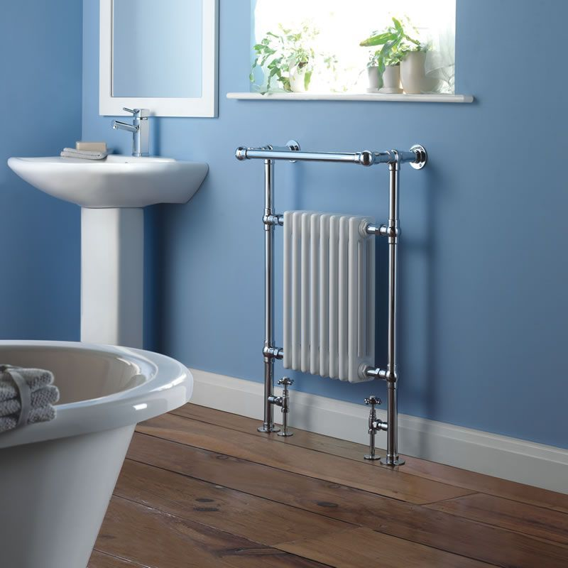 Milano Trent column radiator in a blue bathroom next to a sink