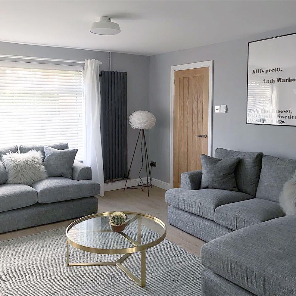 Milano Aruba vertical anthracite radiator in a grey living room