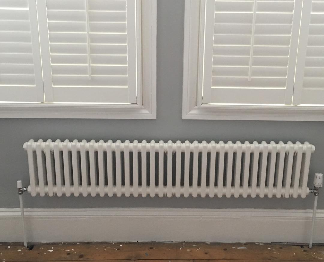 a white Milano Windsor column radiator under a window