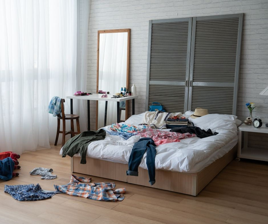 clothes on the floor in a bedroom