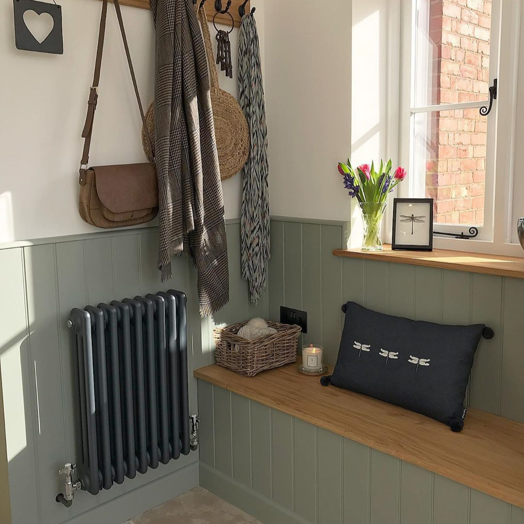 narrow anthracite column radiator in a small boot room
