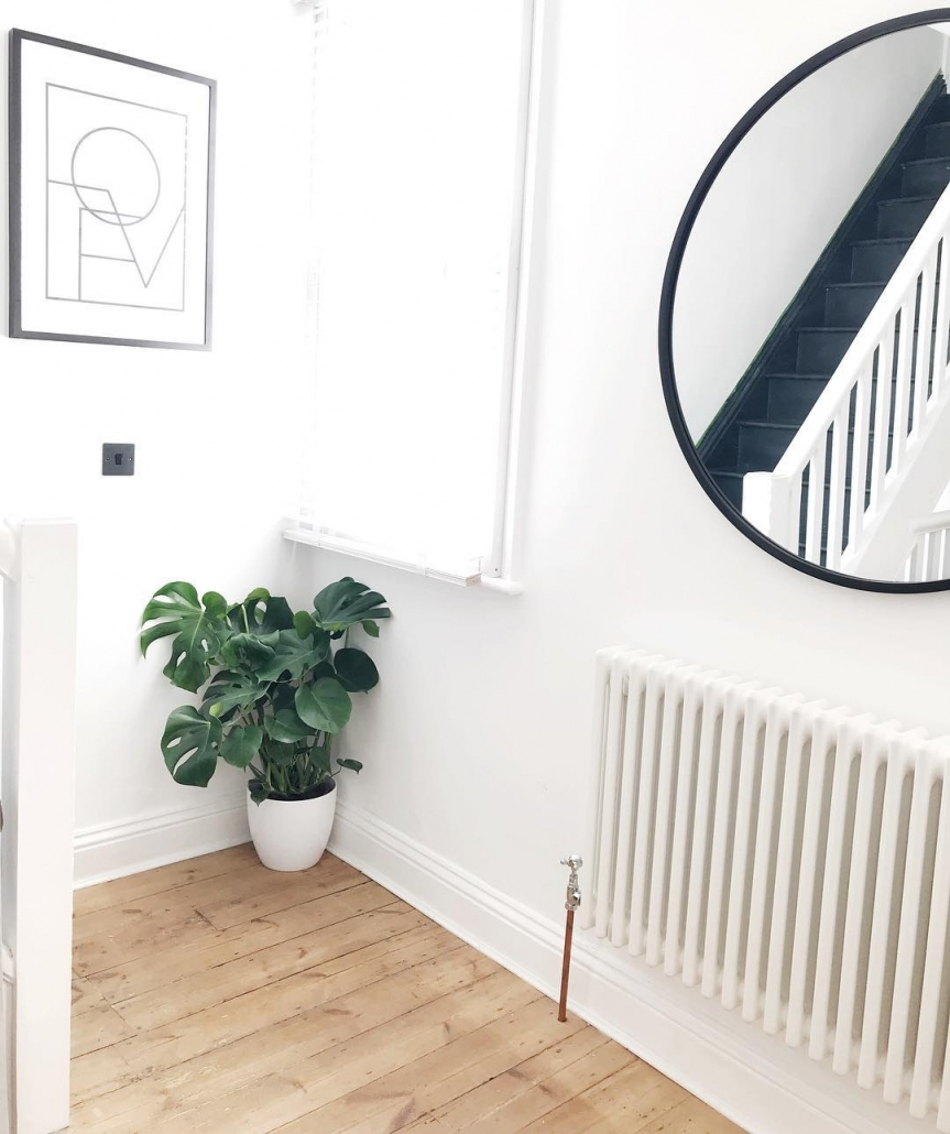 Milano Windsor column radiator in a white hallway.