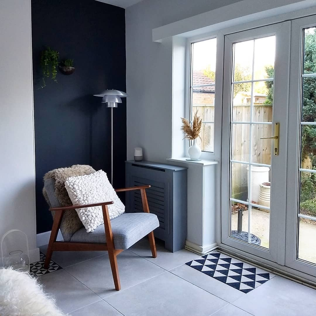 A grey armchair in a Scandinavian style living room.