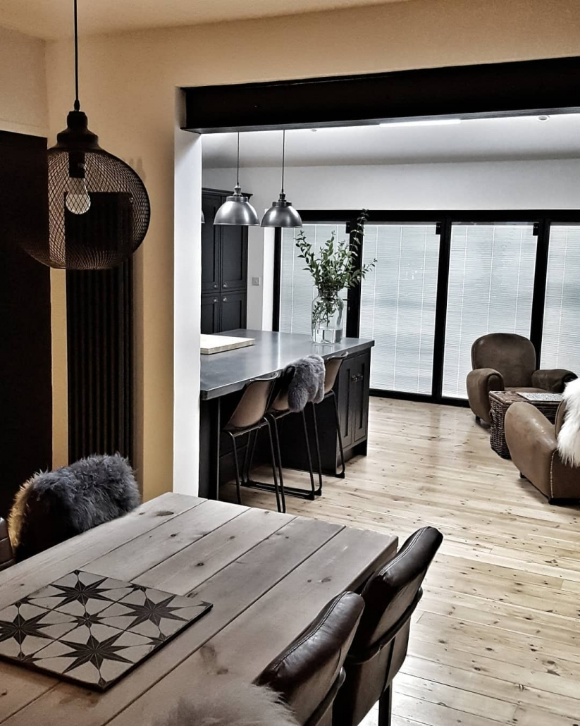 Milano Windsor Anthracite Vertical Radiator in a modern dining room.
