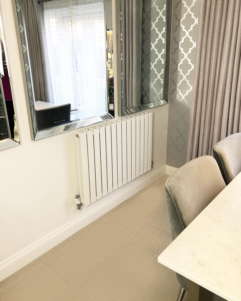 A Milano Alpha Designer radiator from BestHeating on a white wall.