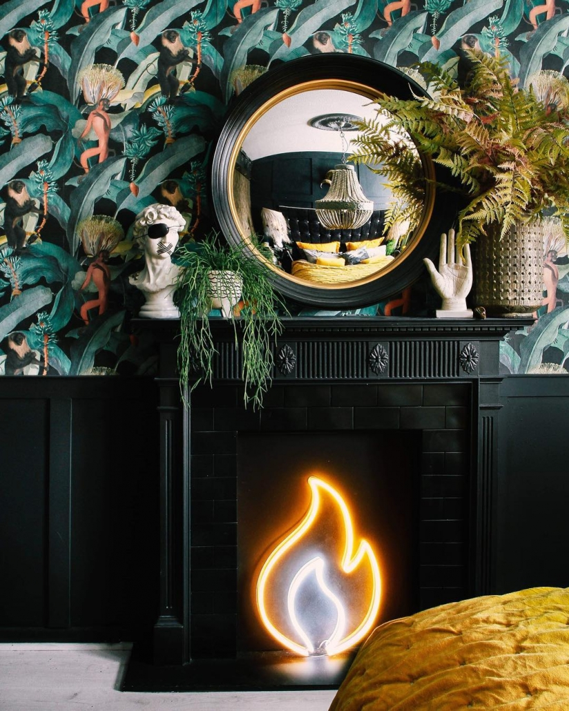 black fireplace with a neon flame