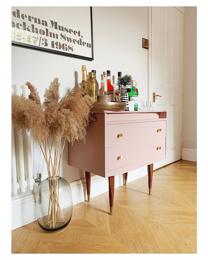 white Milano Windsor radiator next to a pink bar cart