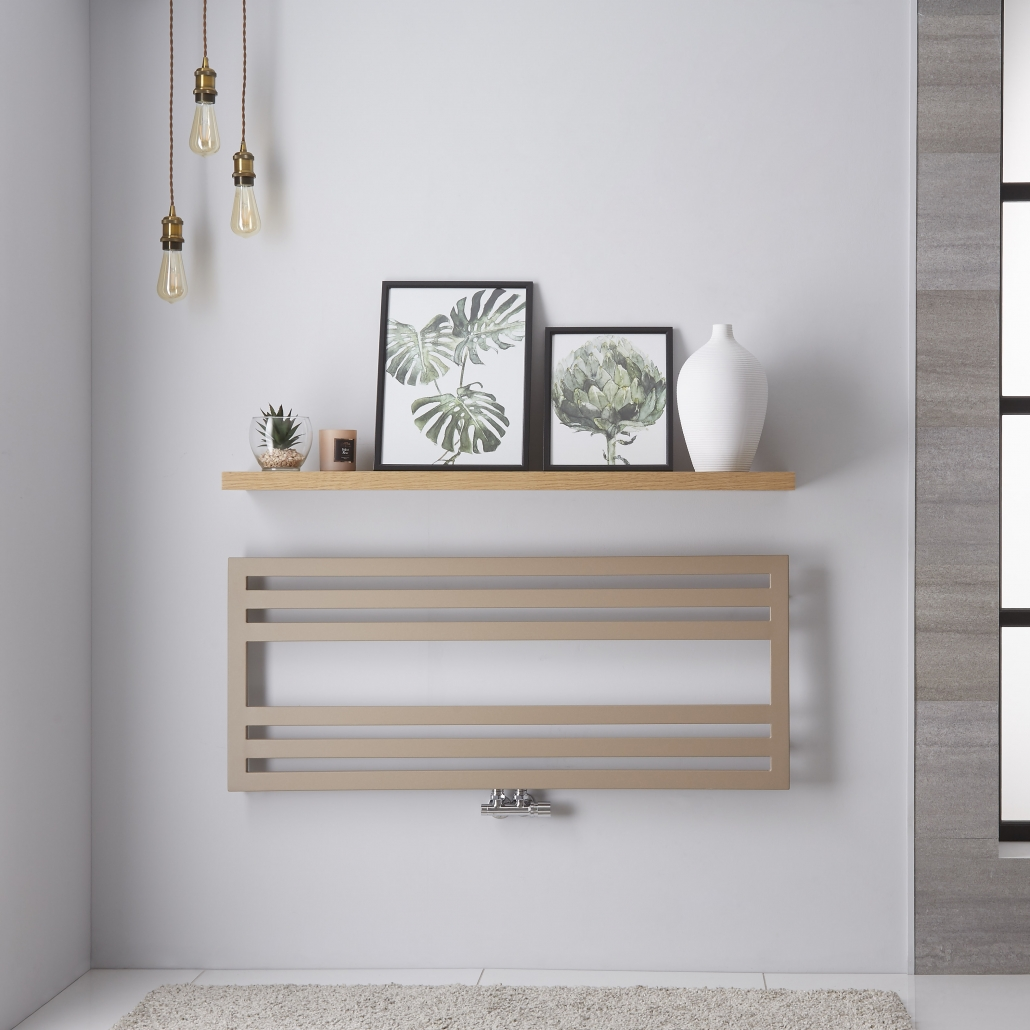 Lazzarini Way Urbino heated towel rail uinder a shelf with picture frames on