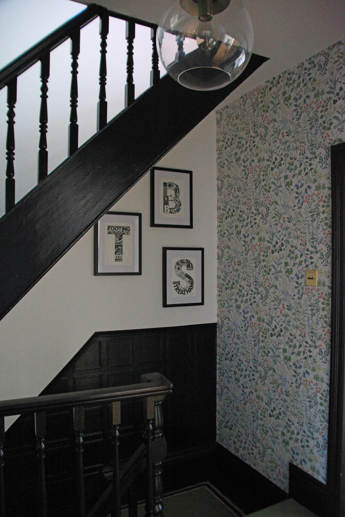 black staircase with a gallery wall