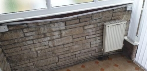old white radiator under a window