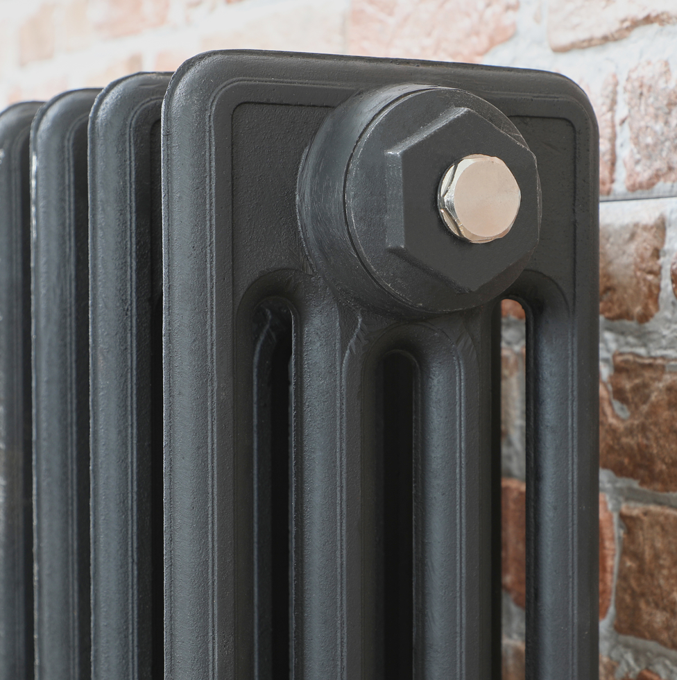 Milano Alice cast-iron radiator charcoal primer close up.
