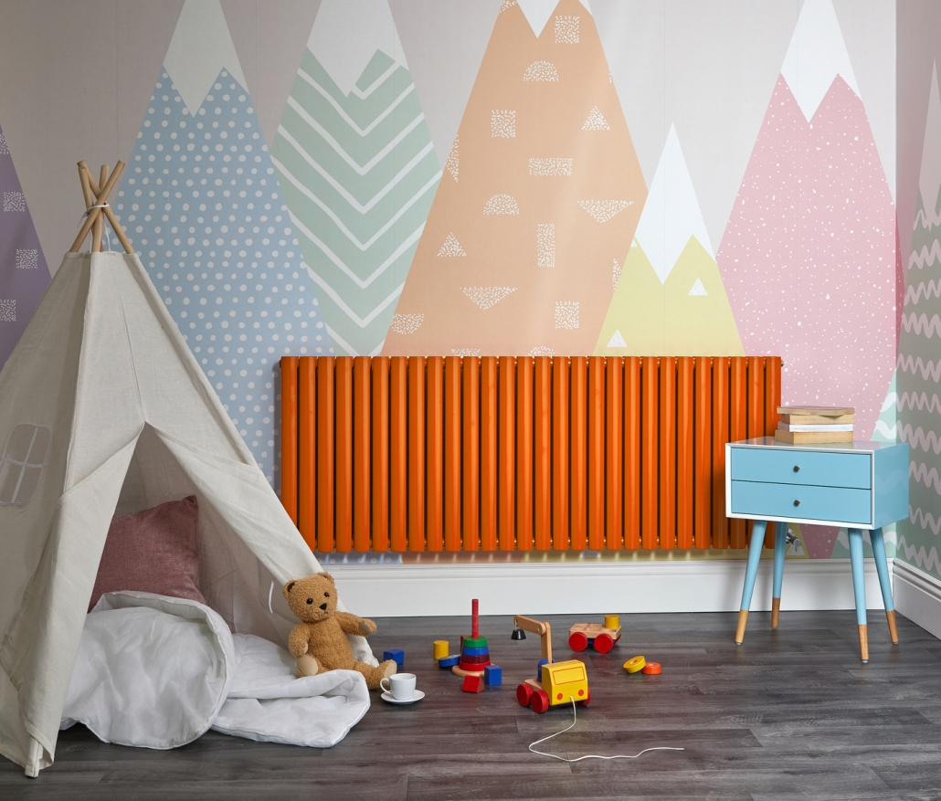Orange Milano Aruba designer radiator in a playroom