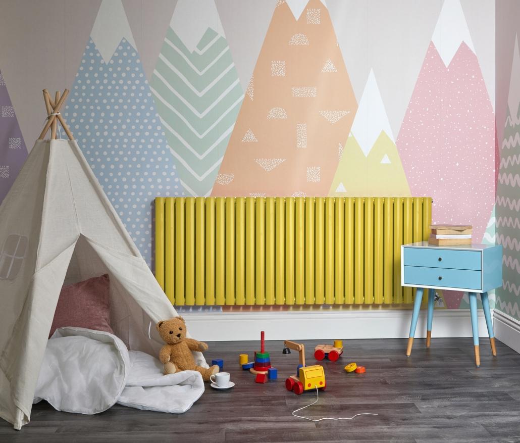 Yellow Milano Aruba designer radiator in a playroom