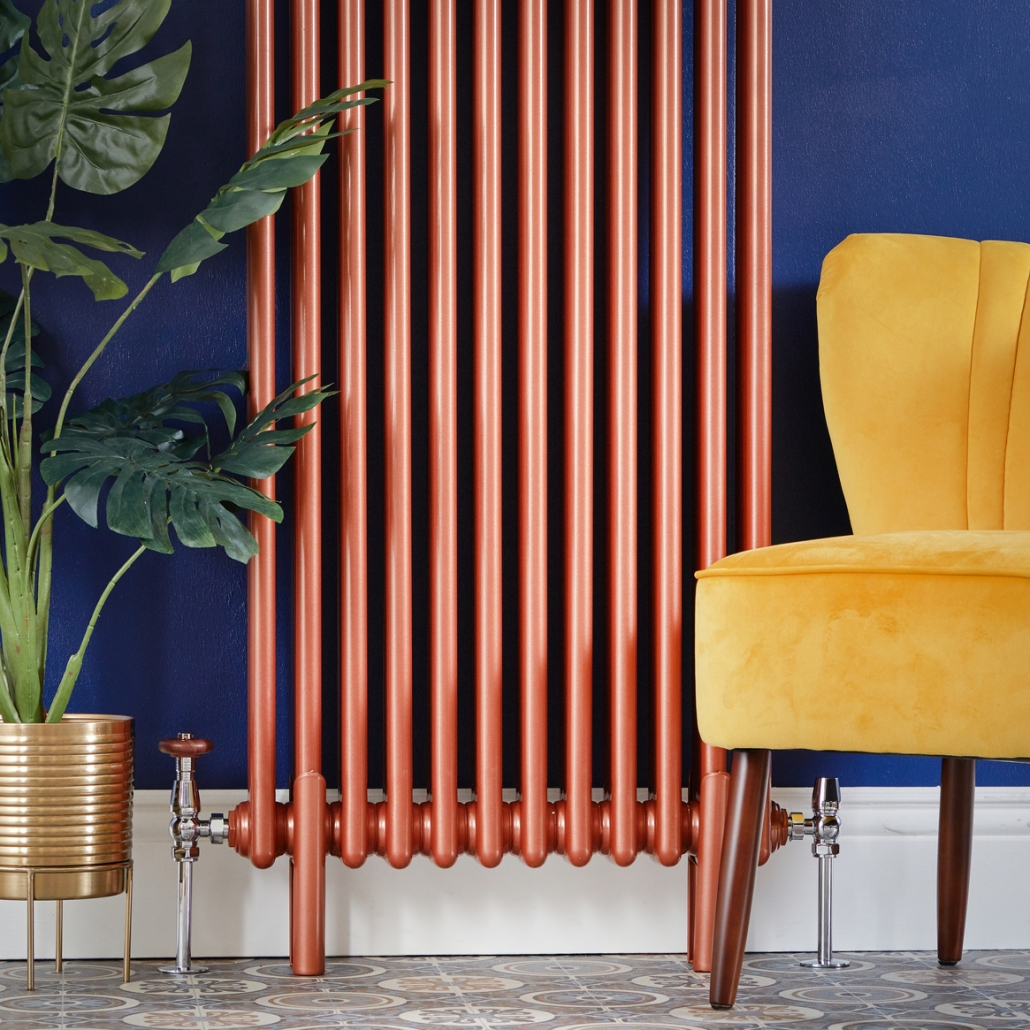 Milano Windsor copper vertical radaitor on a blue wall