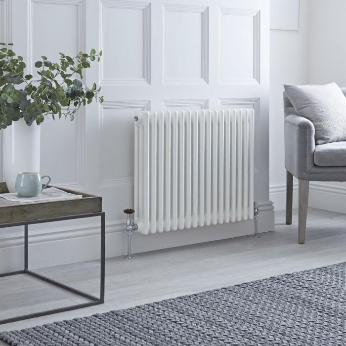 Milano Windsor column radiator in a white livingroom.