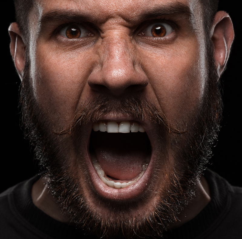 Angry man screaming into the camera