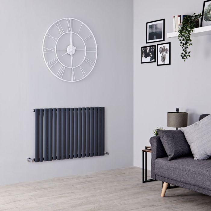Milano Aruba anthracite radiator on a grey wall