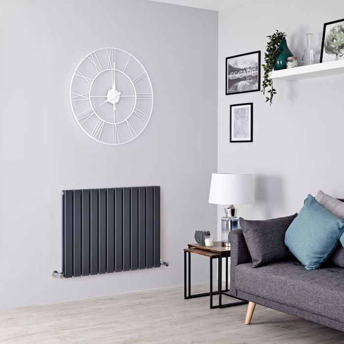 Milano Alpha designer radiator in a grey living room.