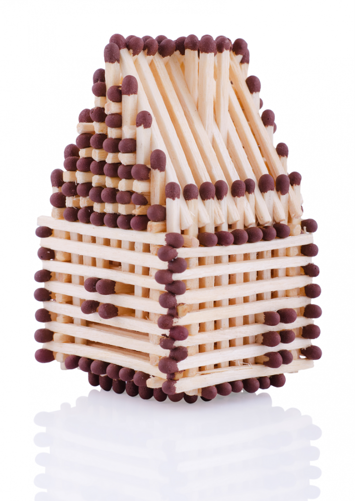 a house made out of matchsticks