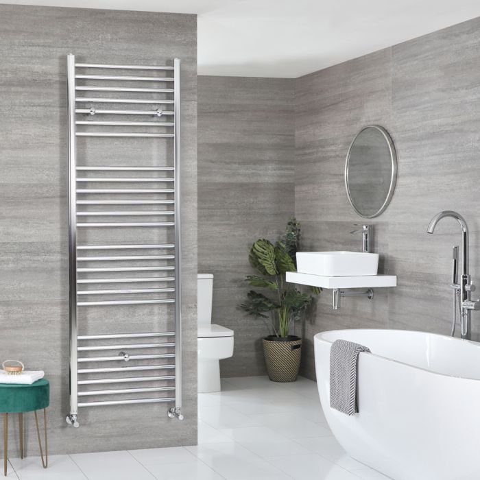Large ladder style Milano Kent heated towel rail in a bathroom
