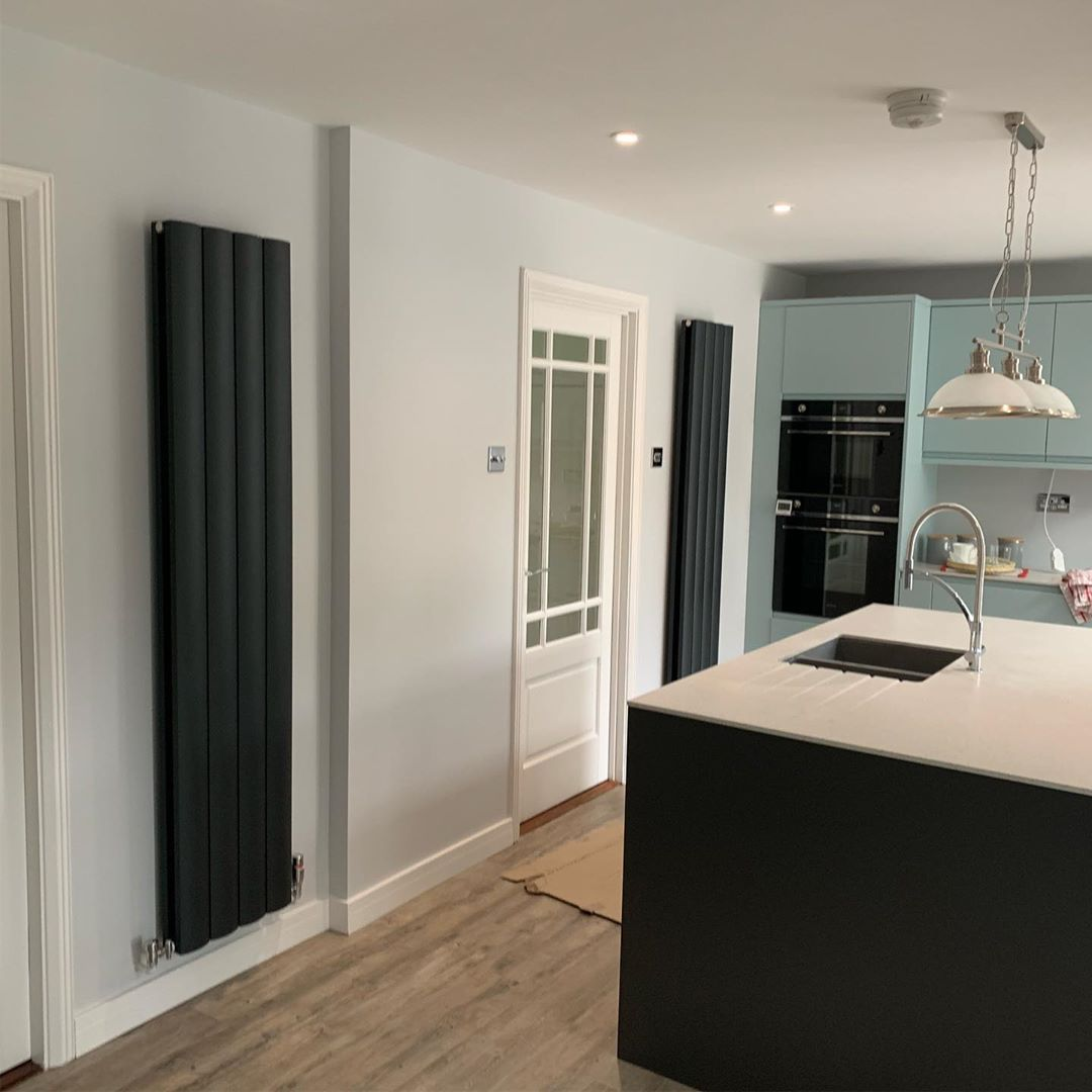 two vertical radiators in a kitchen