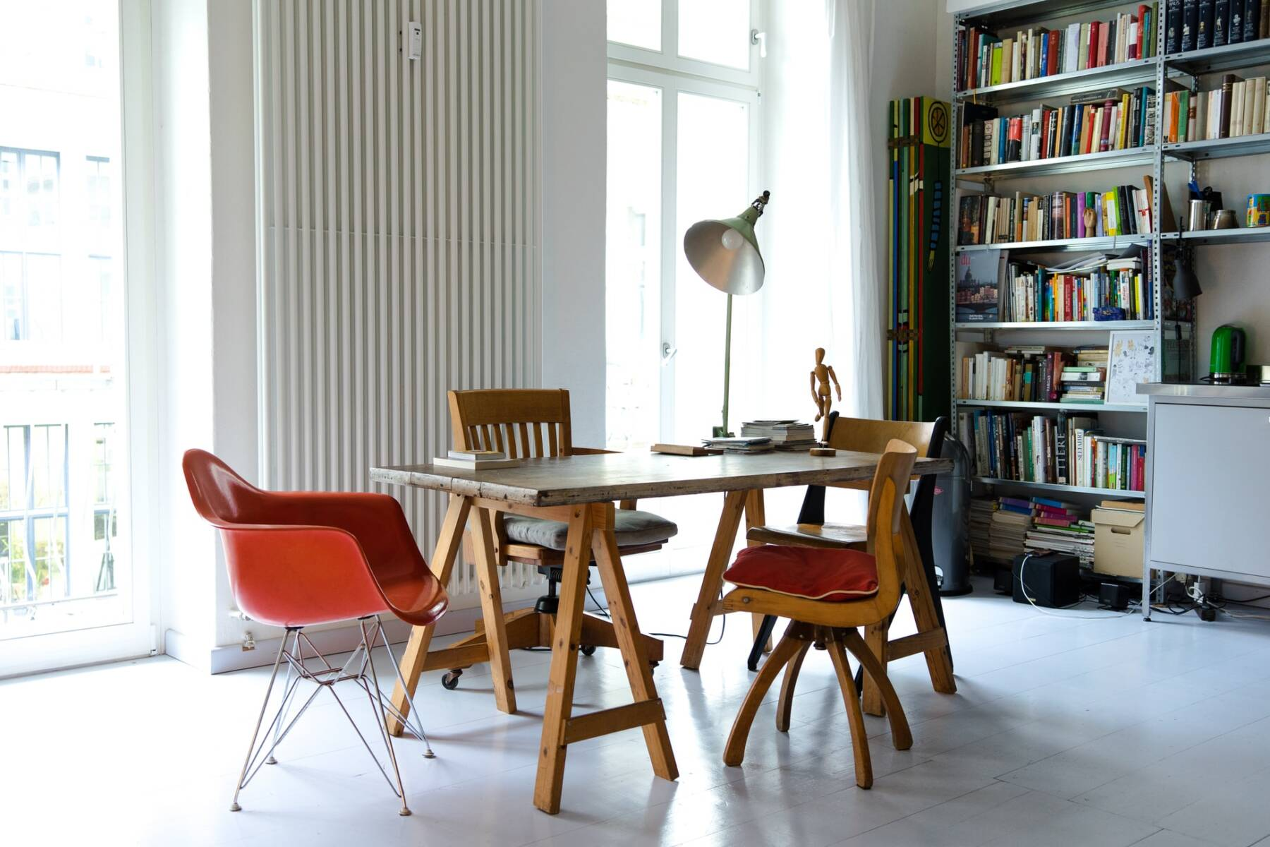 vertical column radiator in a dining room