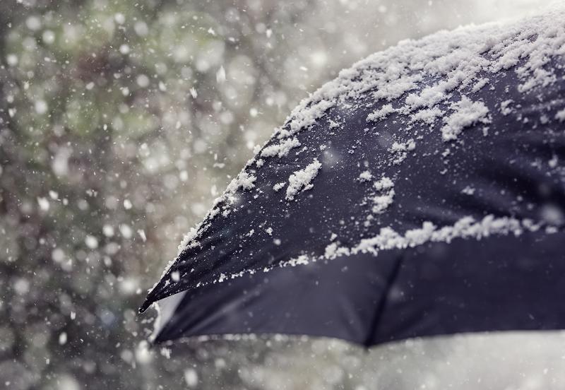 snowflakes falling onto an umbrella