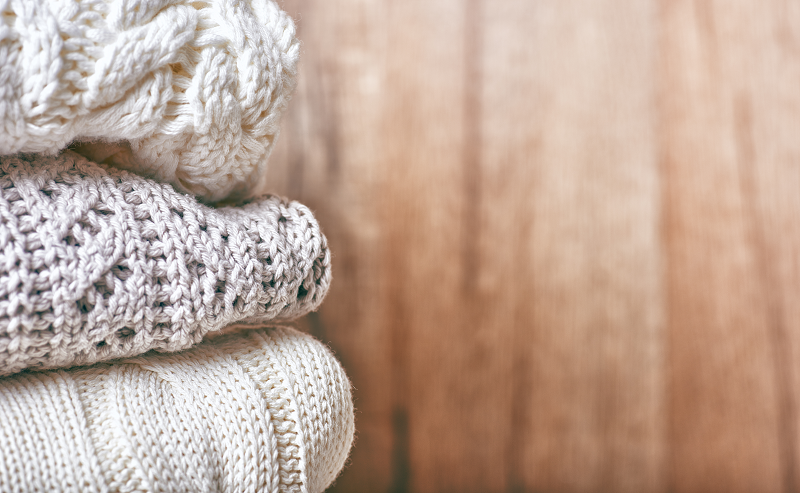 A stack of knitted clothing