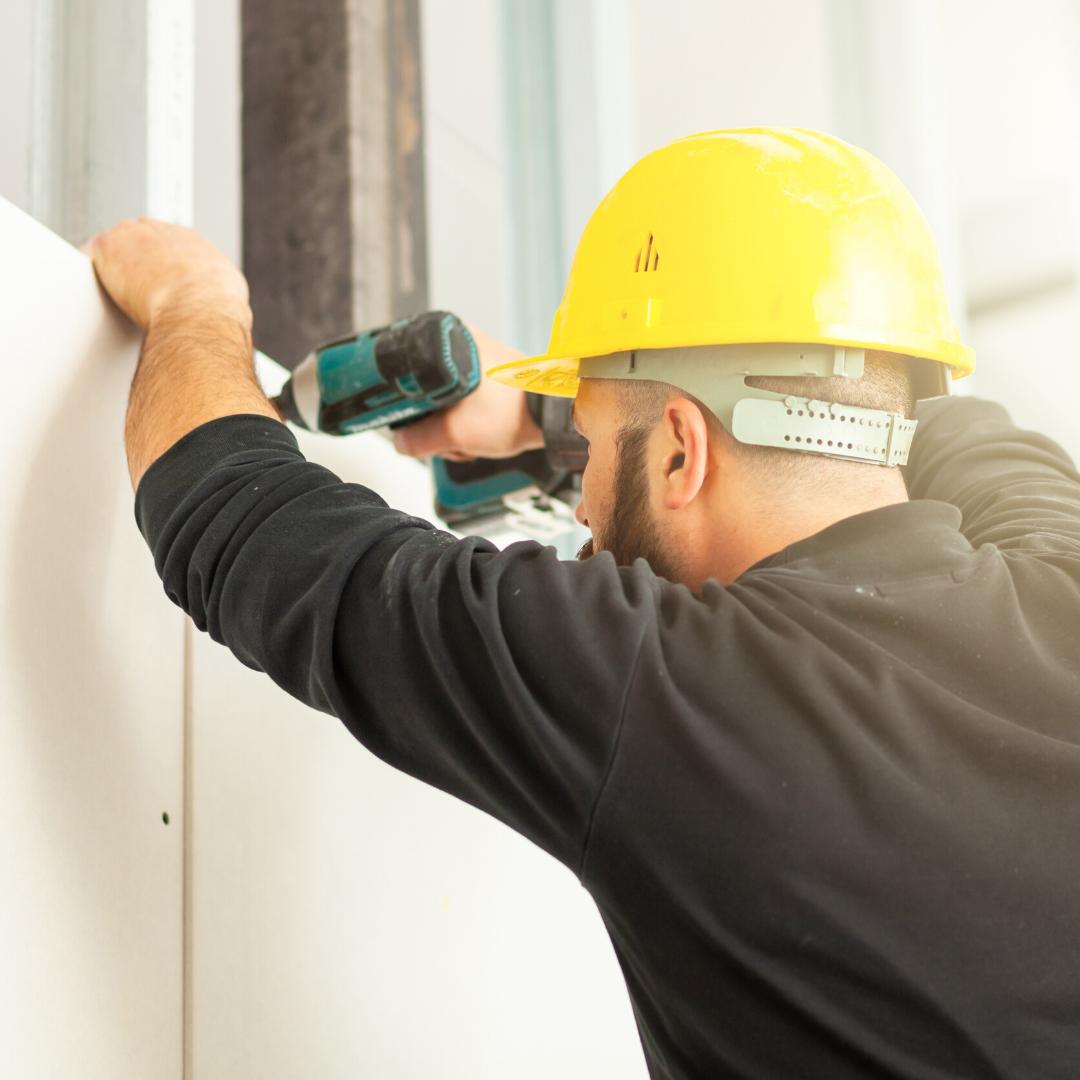 man building a stud wall